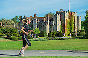 The run (the final event) passes the castle under blue skies - Competitors enjoy the warm sunny conditions while participating in the Hever castle Triathlon.