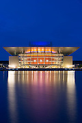 Ultra modern illuminated waterside Opera House by architect Henning Larsen in Copenhagen, Denmark