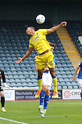 AFC Wimbledon defender Darius Charles (32) jumps for a corner during the EFL Sky Bet League 1 match between Rochdale and AFC Wimbledon at Spotland, Rochdale, England on 27 August 2016. Photo by Stuart Butcher.