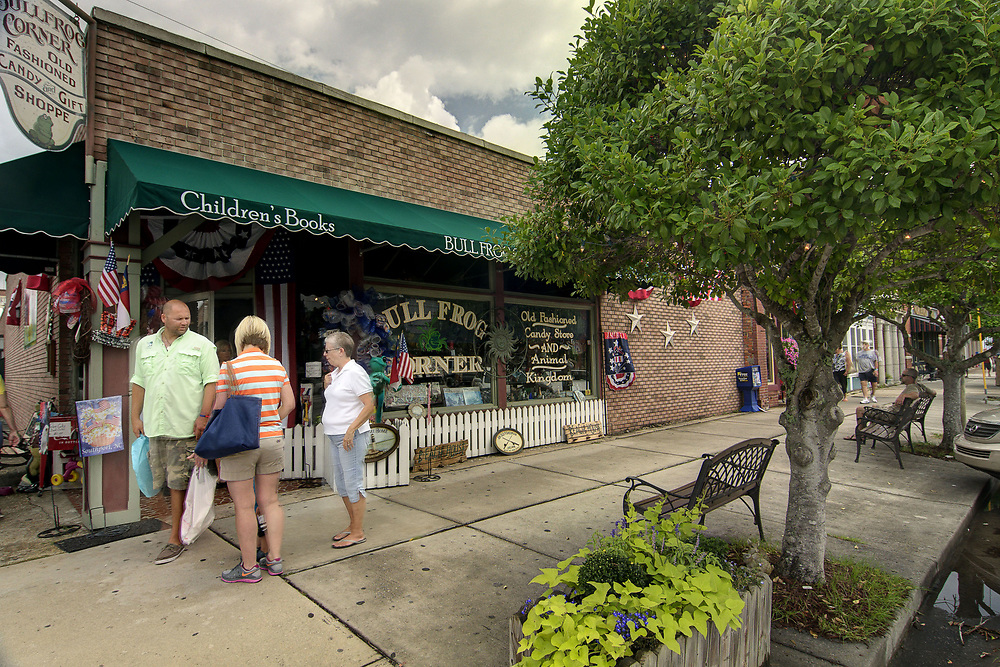 People shop along Moore Street in Southport, NC on Saturday, July 12, 2014. Copyright 2014 Jason Barnette