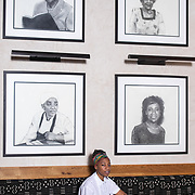 ASHEVILLE, NC - JUNE 29: Chef Ashleigh Shanti of Benne on Eagle, poses for a portrait inside her restaurant on Eagle Street in Asheville, NC on Saturday June 29, 2019. The portraits above her head are of 4 black business owners that once had establishments on Eagle Street. (Photo by Logan Cyrus / The New York Times)