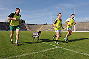 24-5-2012: Kerry GAA players, Tomas O'Se, Darren O'Sullivan and Aidan O'Mahony show their true fitness as they race against 'Try Manhattan'  for fun at the launch of the Bet Daq 'Night of Champions' Kerry team benefit greyhound racing night which will take place in the Kingdom Greyhound Stadium, Tralee on June 30th. On a top class night of dog racing six of the top greyhounds in the country will race for the honour of supreme champion in the feature race..Picture by Don MacMonagle