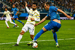 February 21, 2019 - Saint Petersburg, Russia - Artem Dzyuba (R) of FC Zenit Saint Petersburg and Alper Potuk of Fenerbahce SK vie for the ball during the UEFA Europa League Round of 32 second leg match between FC Zenit Saint Petersburg and Fenerbahce SK on February 21, 2019 at Saint Petersburg Stadium in Saint Petersburg, Russia. (Credit Image: © Mike Kireev/NurPhoto via ZUMA Press)