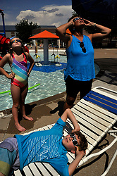 As the moment of totality rapidly approaches, Henry Jennings, 10, in front, his sister Lucy Jennings, 8, and their grandmother Mary Kinney, all of Webster Groves, make sure their glasses are properly on. The pool at the Webster Groves Rec Center opened for special hours Monday, Aug. 21, 2017 for eclipse-watchers. Photo by Hillary Levin/St. Louis Post-Dispatch/TNS/ABACAPRESS.COM