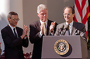US President Bill Clinton applauds as out-going Chief of Staff Erskine Bowles, center, delivers departure remarks as incoming chief John Podesta (left) looks on during a Rose Garden ceremony at the White House October 20, 1998 in Washington, DC. Clinton announced John Podesta as the new chief of staff replacing Bowles.