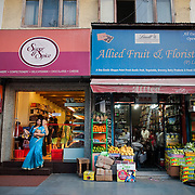 A woman coming out of a deli at Khan market, a posh shopping center in New Delhi