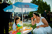 A bride and a little guest at Spring Valley Meadows in  Morganville, New Jersey.