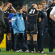 Dan Parks, Scotland, is consoled while in tears at the end of the game after Scotland's loss during the England V Scotland Pool B match during the IRB Rugby World Cup tournament. Eden Park, Auckland, New Zealand, 1st October 2011. Photo Tim Clayton...