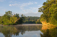 A bluff on the rock river turned to gold as the sun rose.A seasonably cool night caused fog to form on the surface of the river, which lingered for a couple hours.<br />