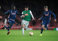 Football - 2020 / 2021 Europa League - Group B - Arsenal vs Rapid Vienna - The Emirates Stadium<br /> <br /> Yusuf Demir of Rapid gets in between Nicholas Pepe and Emile Smith Rowe<br /> <br /> COLORSPORT/ANDREW COWIE