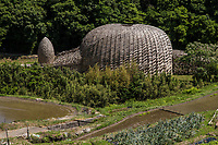 Dream of Olive, by artist Wang Wen Chih is a large dome made of over locally grown bamboo.  The theme is olives, which is the chief product from Shodoshima island where the instalation is located. The interior becomes a stage on which visitors can wander around during the Setouchi Art Fest. The dome transforms the look of the surrounding landscape which is composed of rice terraces.