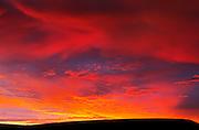 Fiery skies and sunset in Killdeer Badlands. West Block.<br /> Grasslands National Park<br /> Saskatchewan<br /> Canada