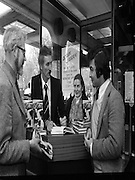 Derek Dougan's name goes in the book.<br /> 1980-04-16<br /> 16th April 1980<br /> 16-04-1980<br /> 04-16-80<br /> Photographed at Hodges Figgis, Stephen's Court, St Stephen's Green, Dublin. Former Northern Irish soccer international and English League player Derek Dougan signing a copy of his book 'Doog' for customer Peter Moynihan, Sandyford, Co Dublin (right of picture). Also in picture, Robert Twigg, manager of Hodges Figgis and cashier Norma Doyn (Tallaght, Dublin).