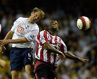 Photo: Daniel Hambury.<br />Tottenham Hotspur v Sheffield United. The Barclays Premiership. 22/08/2006.<br />Tottenham's Teemu Tainio and Sheffield's David Sommeil battle.