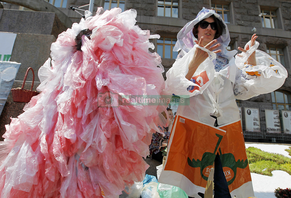 May 26, 2019 - Kiev, Ukraine - An Ukrainian woman wearing plastic bags attends an eco rally 'Plastic bags's march' in front the Kiev City Hall building in Kiev, Ukraine, on 26 May 2019. The activists demand introduce restrictions on the use of plastic bags and to solve the problem of using and processing of polyethylene and other plastic packaging in Ukraine. (Credit Image: © Serg Glovny/ZUMA Wire)