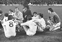 Football -  1969 / 1970 FA Cup final replay <br /> Chelsea v Leeds United, 29/04/1970<br /> <br /> Leeds Manager, Don Revie talks to his players before extra time at Old Trafford.<br /> l-r : Jackie Charlton (back-left),Allan Clarke (8),Cyril Partridge (trainer),Terry Cooper,Paul Madeley,Norman Hunter and goalkeeper, David Harvey.<br /> <br /> Credit: Colorsport  / Provincial press