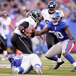 Quarterback David Garrard #9 of the Jacksonville Jaguars runs from pressure during NFL football action between the New York Giants and Jacksonville Jaguars on Nov. 28, 2010 at MetLife Stadium in East Rutherford, N.J.