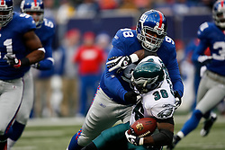 7 Dec 2008: Philadelphia Eagles running back Brian Westbrook #36 is taken down by New York Giants defensive tackle Fred Robbins #98 during the game against the New York Giants on December 7th, 2008. The Eagles won 20-14 at Giants Stadium in East Rutherford, New Jersey. (Photo by Brian Garfinkel)