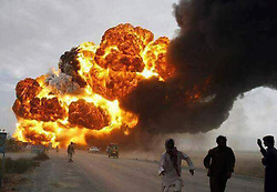 June 25, 2017 - Ahmed Pur Sharqia, Punjab, Pakistan - (Cellphone photo) At least 146 people were killed and scores injured in a fire that broke out after an oil tanker overturned in Ahmad Pur Sharqia area of Bahawalpur, Pakistan. Crowds rushed to collect fuel, an official said. According to media reports, the accident occurred after dozens of people from nearby localities gathered to collect oil from the overturned tanker when it blew up. At least 75 motorbikes and six cars passing by also burnt by blaze. (Credit Image: © Rana Sajid Hussain/Pacific Press via ZUMA Wire)