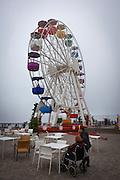Clouds envelope the amusement park ferris wheel at Tibidabo, Barcelona.