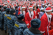 Moscow, Russia, 17/12/2005.&#xA;Putin supporters dressed as Santa Claus march past a line of riot police. Approximately 70,000 members of the pro Kremlin youth organisation Nashi [Ours],  demonstrated to wish World War Two veterans a happy New Year. Most of the demonstrators were dress as Dyed Moroz, the Russian Santa Claus, or his partner Snegurichka, the Snow Maiden.<br />