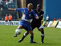 Photo: Olly Greenwood.<br />Gillingham v Swansea City. Coca Cola League 1. 16/09/2006. Gillingham's Mark Bentley (L) and Swansea's Kevin Austin battle.