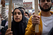 A young woman wearing a black head scarf during a Free Kashmir protest at Parliament Square on the 3rd September 2019 in London in the United Kingdom. Protesters gather near the statue of Mahatma Gandhi in solidarity following Indian Prime Minister Narendra Modi's Independence Day speech removing special rights of Kashmir as an autonomous region.