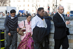© Licensed to London News Pictures. 04/01/2012. London, UK.  L to R RAKESH SONAWANE (Brother-in-law) YOGINI BIDVE (mother), SUBHASH BIDVE (Father), and Keith Vaz (Leicester MP) arriving at the Houses of Parliament London on January 4th, 2012 after arriving in the UK from Mumbai. The Family of 20 year-old ANUJ BIDVE, are expected to travel to Manchester to visit the scene where ANUJ was shot dead.  Photo credit: Ben Cawthra/LNP