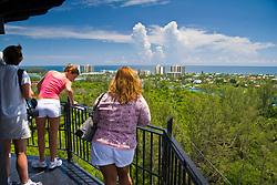 tourists enjoying panoramic views from the top of Jupiter Inlet Lighthouse, Jupiter, Florida, USA, Atlantic Ocean
