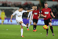 Jack Cork of Swansea city in action (l).Barclays Premier league match, Swansea city v West Bromwich Albion at the Liberty Stadium in Swansea, South Wales  on Boxing Day Saturday 26th December 2015.<br /> pic by  Andrew Orchard, Andrew Orchard sports photography.
