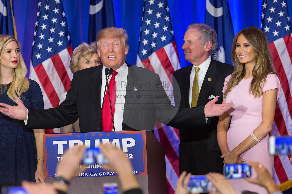 Billionaire and GOP presidential candidate Donald Trump acknowledges cheering supporters along with his wife Melania and daughter Ivanka and Lt. Gov. Henry McMasters as they celebrate victory in the South Carolina Republican primary February 20, 2016 in Spartanburg, South Carolina, USA .