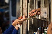 A guest grabs an ice cream sundae at J Shack, a Japanese Creperie, during Off the Grid at the Great Mall of the Bay Area in Milpitas, California, on May 12, 2016. (Stan Olszewski/SOSKIphoto)