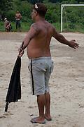 An exasperated bystander during the all women's football match in Jardim São Marcos favela, Cubatão