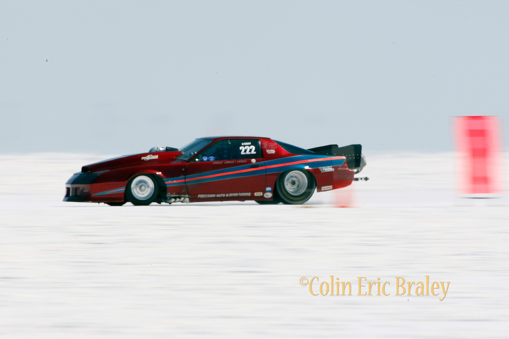 Best cars-people-atmosphere-photos of 2009 Bonneville Speed Week- Langlo Racing's 1988 Chevy Camaro, owned and driven by John Langlo of Clovis CA. passes the 5-mile mark during a run at the Bonneville Speed Way. August 9, 2009.  Photo by Colin E. Braley