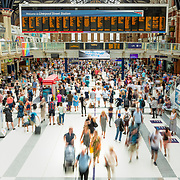 Forecourt of Liverpool Street station, London with crowds of commuters