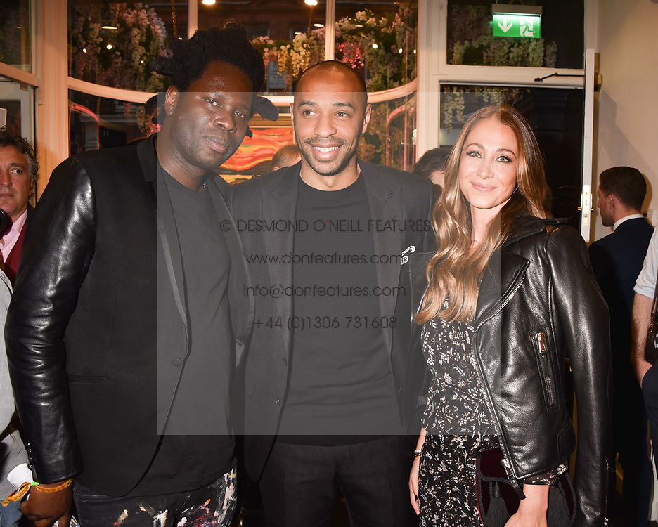 Left to right, artist Bradley Theodore, Thierry Henry and Andrea Rajacic at a private view of work by Bradley Theodore entitled 'The Second Coming' at the Maddox Gallery, 9 Maddox Street, London England. 19 April 2017.