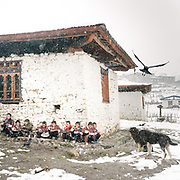Lunch break during a snow storm. Visiting the only school in Laya village.