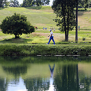 Sergio Garcia, Spain, heads to the 16th green while reflected in a pond during the final round of the Travelers Championship at the TPC River Highlands, Cromwell, Connecticut, USA. 22nd June 2014. Photo Tim Clayton