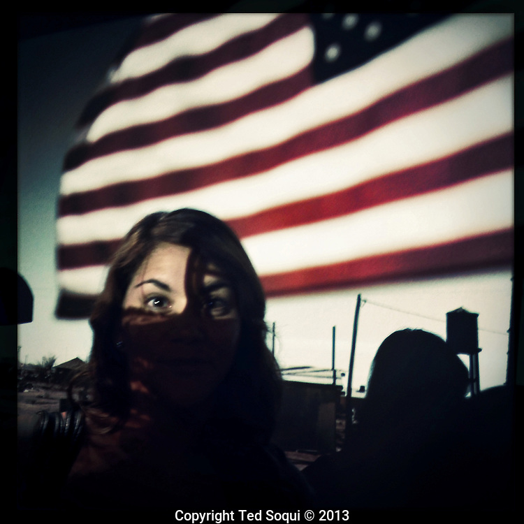 A former Marine with the US flag projected over her face.