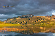 Steamboat Mountain reflects into wetlands pond along the Rocky Mountain Front near Augusta, Montana, USA