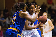 San Francisco Lady Dons forward Claudia Price (22) attacks the basket against the San Jose State Spartans at Kezar Pavilion in San Francisco, Calif., on December 6, 2016. (Stan Olszewski/Special to S.F. Examiner)