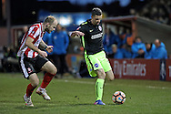 Brighton & Hove Albion winger Jamie Murphy (15) breaks forward during the The FA Cup fourth round match between Lincoln City and Brighton and Hove Albion at Sincil Bank, Lincoln, United Kingdom on 28 January 2017.