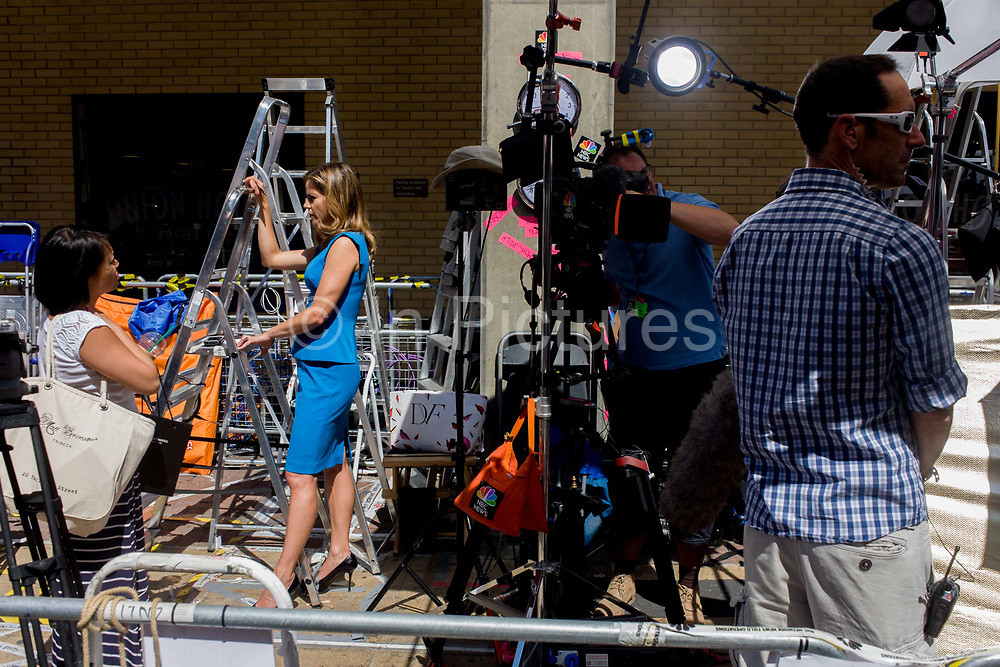 US NBC TV reporter Natalie Morales with technicians reports live for Today from media village behind railings as tension mounts outside St Mary's Hospital, Paddington London, where media and royalists await news of Kate, Duchess of Cambridge's impending labour and birth. Some have been camping out for up to two weeks during a UK heatwave, having bagged the best locations where an heir to the British throne will eventually be shown to the world.