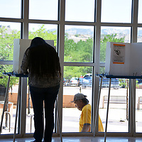 A voter marks her ballot in the Rotunda of the McKinley County Courthouse during Tuesday's primary election in Gallup.