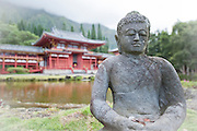 A statue in front of the Byodo-In Temple.