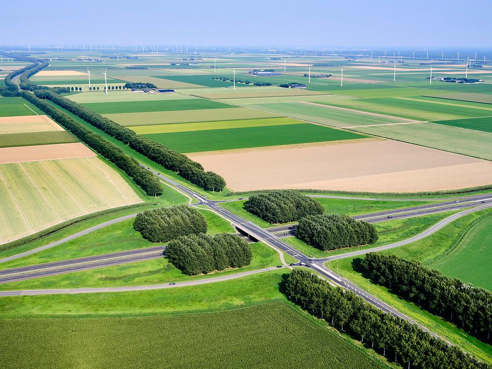 Nederland, Flevoland, Almere Hout, 26-08-2019; Provinciale weg N706, Vogelweg, kruising met A27. De beplanting van de Vogelweg is een voorbeeld van de landschapsarchitectuur van Flevoland.<br /> Vogelweg, example of landscape architecture in the new polder Flevoland.<br /> <br /> luchtfoto (toeslag op standard tarieven);<br /> aerial photo (additional fee required);<br /> copyright foto/photo Siebe Swart