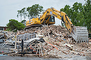 Contractors demolish the Hiddden Pines Apartments as part of construction for the new Lee High School, April 22, 2015.