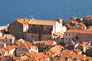View from above of the old town with city walls and fort brick coloured rooftops roof tops, detail of Church Saint Ignace de Loyola Sv Ignacije Dubrovnik, old city. Dalmatian Coast, Croatia, Europe.