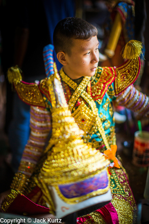 13 JANUARY 2013 - BANGKOK, THAILAND:  A boy in a formal Thai costume waits to dance a scene from the Ramayana as Hanuman, the Monkey God, at an artists' space in the Bang Luang neighborhood. The Bang Luang neighborhood lines Khlong (Canal) Bang Luang in the Thonburi section of Bangkok on the west side of Chao Phraya River. It was established in the late 18th Century by King Taksin the Great after the Burmese sacked the Siamese capital of Ayutthaya. The neighborhood, like most of Thonburi, is relatively undeveloped and still criss crossed by the canals which once made Bangkok famous. It's now a popular day trip from central Bangkok and offers a glimpse into what the city used to be like.    PHOTO BY JACK KURTZ