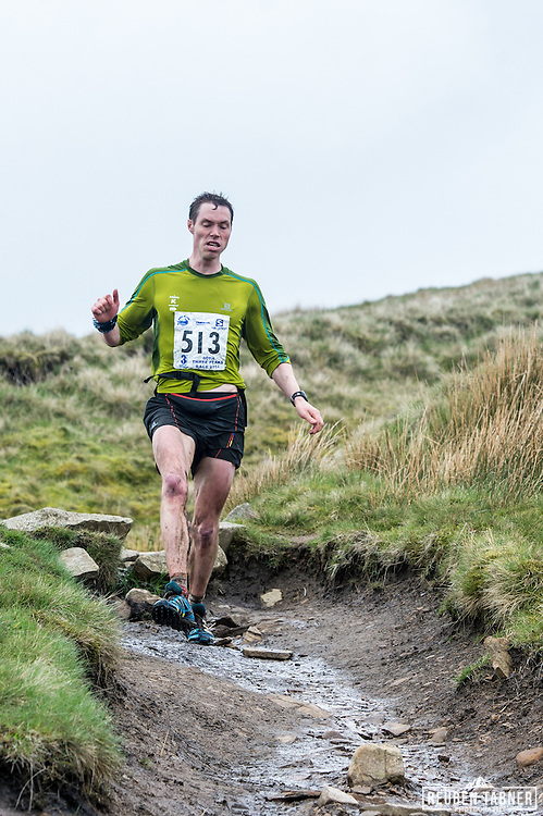 Tom Owens makes his way down Ingleborough in the Yorkshire Dales during the 60th Yorkshire Three Peaks Race.